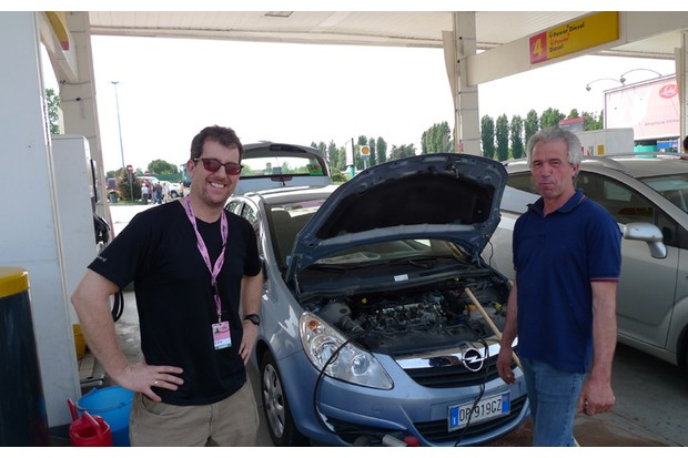 Dan Friebe's travelling companion Andy Hood gets some help after filling the diesel engine with petrol