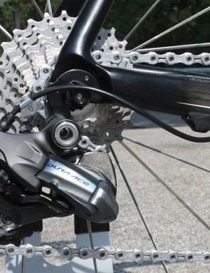 The rear derailleur wire exits the frame just before it connects out back.