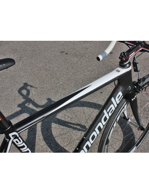 The SuperSix Hi-Mod Di2 will be the lightest frame as it uses the least amount of paint.