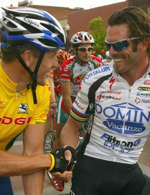 Lance Armstrong and Mario Cipollini shake hands before the start of Stage 5 of the 2004 Tour de Georgia.