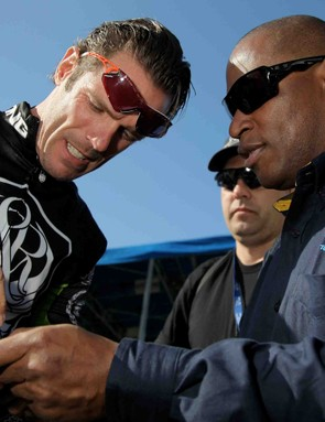 1984 Olympic track cycling medalist Nelson Vails (R) gets Cipo's autograph before Stage 3 of the 2008 Tour of California.