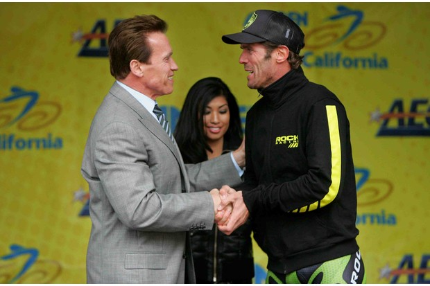 California governor Arnold Schwarzenegger welcomes Mario Cipollini of Italy and riding for Rock Racing to the stage after he finished third in Stage 2 of the Amgen Tour of California on February 19, 2008 from Santa Rosa to Sacramento, California.