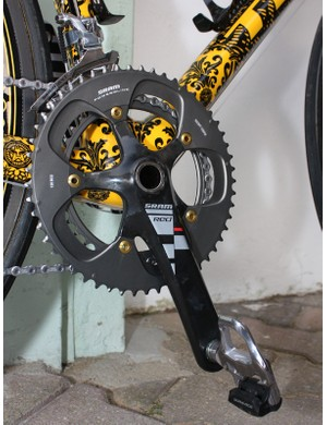 The SRAM Red crankset is slightly tweaked with the addition of gold-anodised aluminium chainring bolts