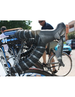 Team mechanics use a combination of extra layers of tape and Fizik gel padding to get Wiggins' bars where he likes them