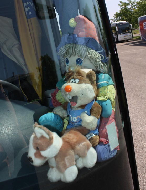 The ag2r bus had stuffed animals behind its windscreen
