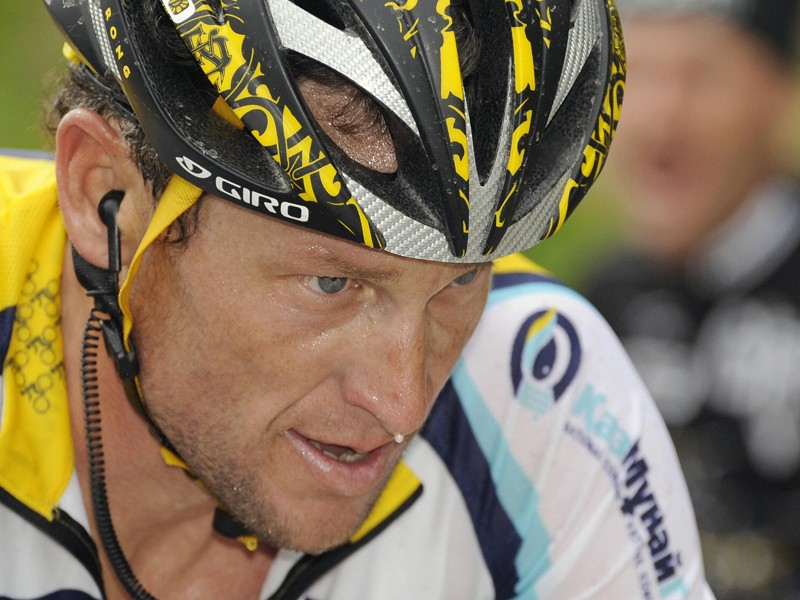 Lance Armstrong and his Astana team-mates have blocked out their sponsor's name