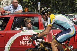 Lance Armstrong talks to the race jury about safety measures during stage 9