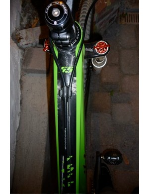 Sleek lines of the custom Ibis Tranny top tube, with Lopes' signature 55, of course.