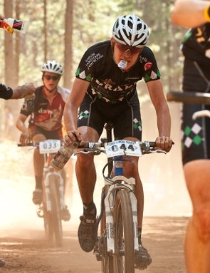 Members of the Varsity Boys race take full advantage of the FeedZone amid very hot, dry and dusty conditions.