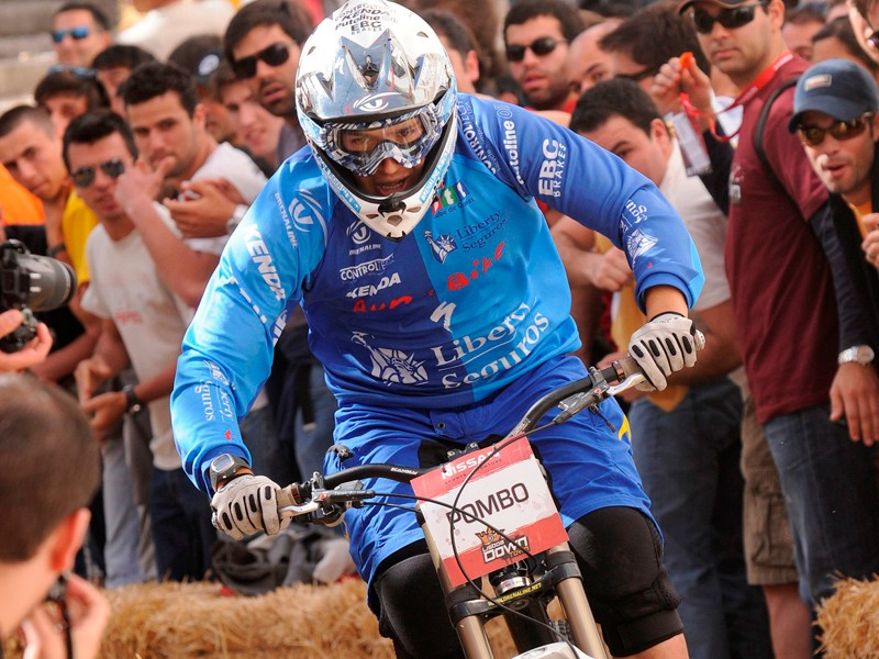 Portuguese rider Emanuel Pombo descends the course to fourth place