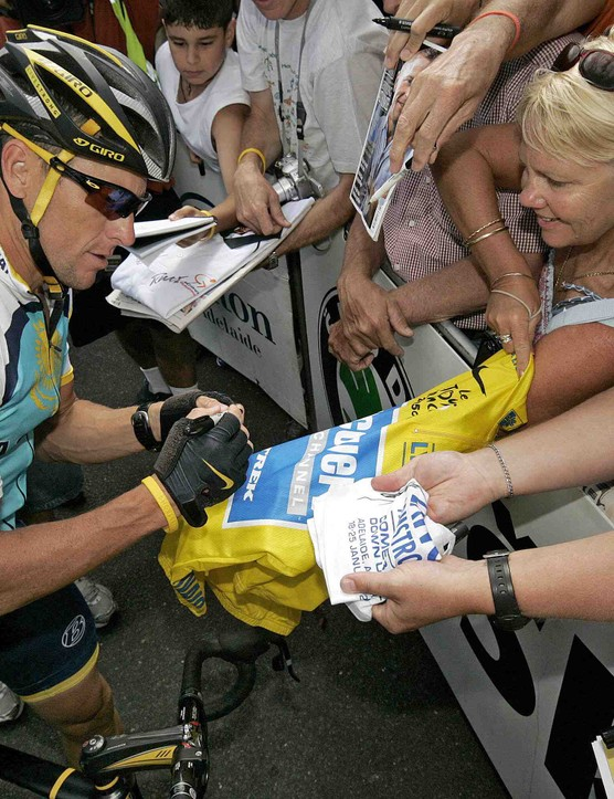 Seven-time Tour de France winner Lance Armstrong signs autographs before stage four of the Tour Down Under in Adelaide on January 23, 2009.