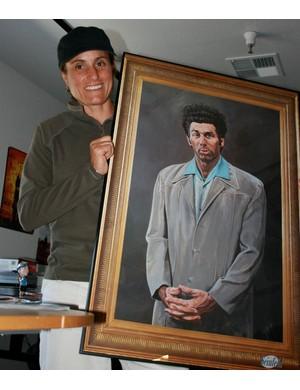 Juli and her prized possession: a framed portrait of The Kramer