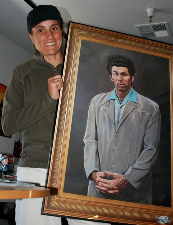 Juli and her prized possession: a framed portrait of The Kramer