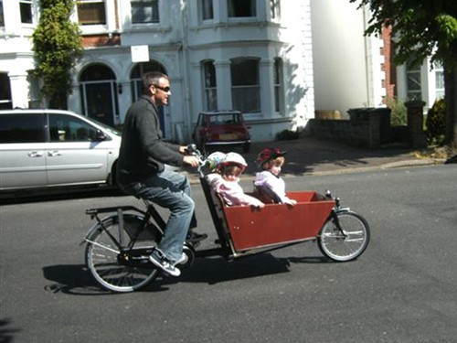 Scott Sale of Hove uses his bike to transport his triplets