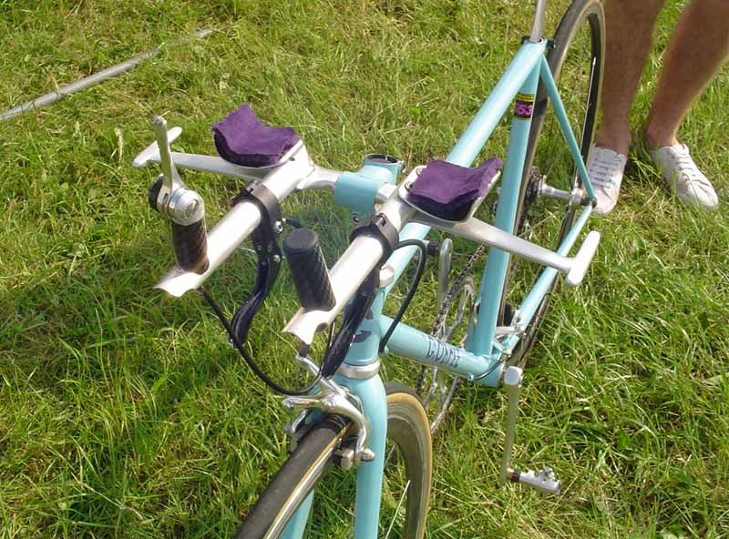 Custom made handlebars with purple pads. OK for local time trialling, not for the record attempt