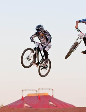 Marc Beaumont (L) and Danny Hart get airborne on the first jump