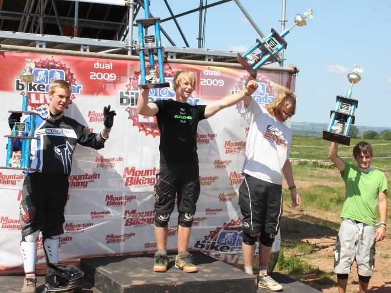 Jake Ward, Alex Metchalf and Mop Head on the podium
