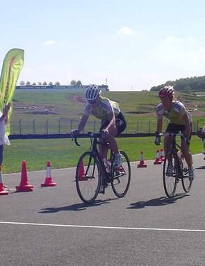 Emma Davies crosses the line in front of her HotChillee teammate Alice Monger-Godfrey