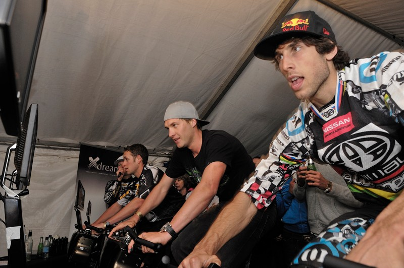 World Cup downhillers Marc Beaumont, Greg Minnaar and Gee Atherton test their skills on Trixter's X-Dream exercise bikes