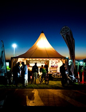Night falls but the start/finish tent is a hive of activity
