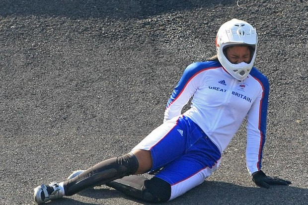Britain's Shanaze Reade grimaces in pain after falling from her bike during a semi-final heat in the women's BMX finals at the 2008 Beijing Olympic Games at Laoshan BMX venue on August 22, 2008