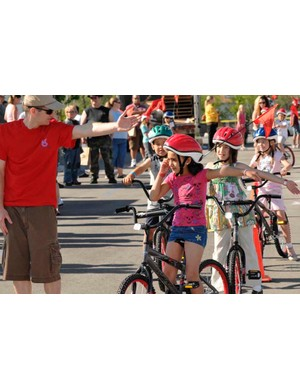 Utah second graders are given proper bicycle safety instruction after receiving a new bike and helmet.