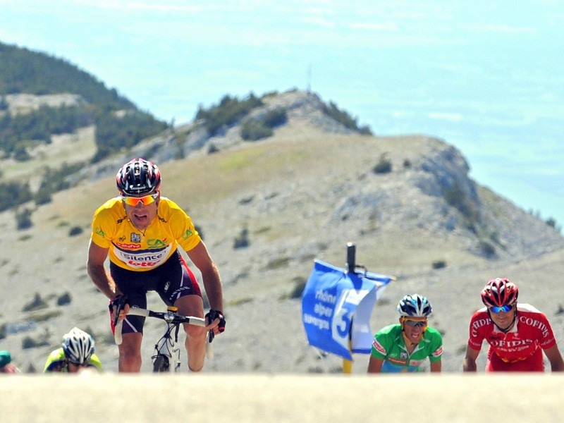 Cadel Evans sprints to the top of Mont Ventoux after hearing that another episode of the Cyclingnews podcast is available