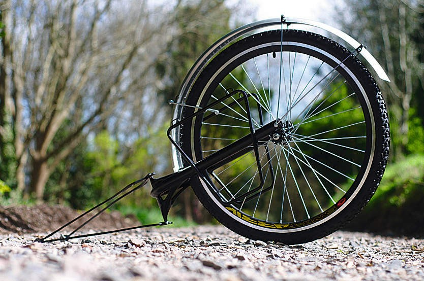 Use a 26in or 700C wheel and you have a spare for your bike should disaster strike