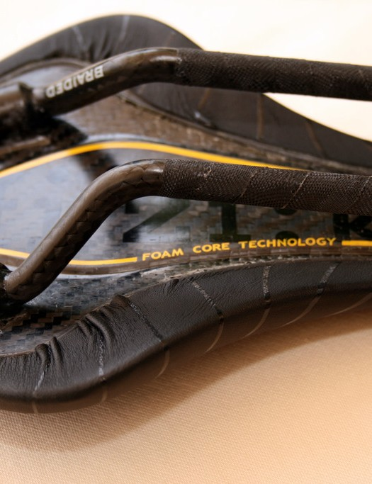 Braided carbon rails protected by fi'zi:k's trademark wrap.