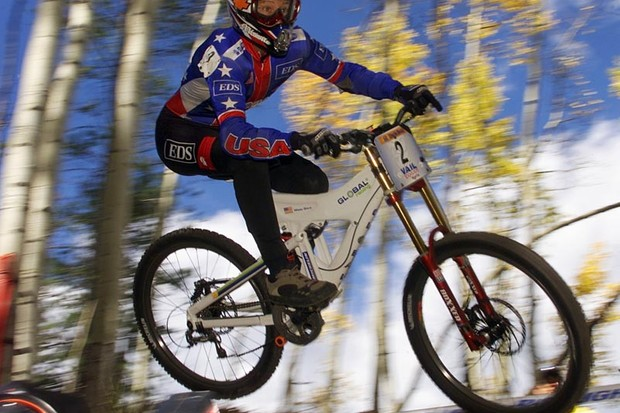15 Sep 2001: Missy Giove #2 of the USA catches some air coming around a turn during the downhill portion of the UCI Mountain Bike World Championships in Vail, Colorado