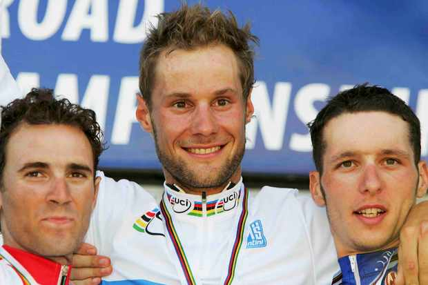 Alejandro Valverde (L - Spain), Tom Boonen (C - Belgium) and Anthony Geslin (France) stand on the podium after the Elite Men's World Road Race Championship on September 25, 2005, in Madrid, Spain.