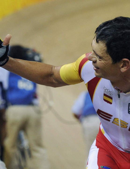 Track cyclist Joan Llaneras of Spain celebrates after winning, with partner Antonio Tauler, the 2008 Beijing Olympic Games men's madison final at the Laoshan Velodrome in Beijing on August 19, 2008.