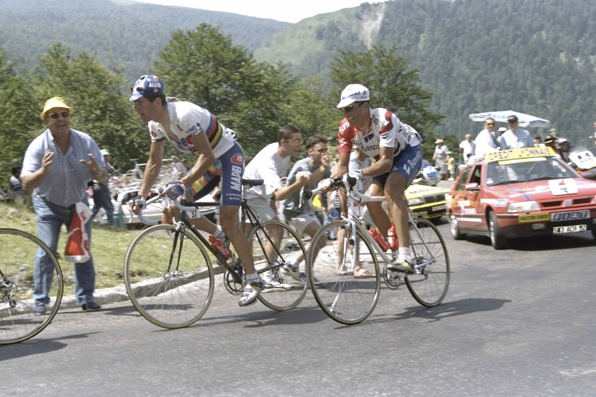 Abraham Olano of Spain (left) leads Miguel Indurain of Spain as they sruggle up the climb during stage 17 of the 1996 Tour De France from Argeles Gazost to Pampelune.