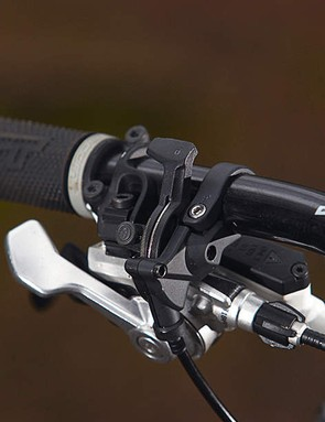 The rear shock's remote lockout is easy to use, but can provoke bounciness under seated pedalling