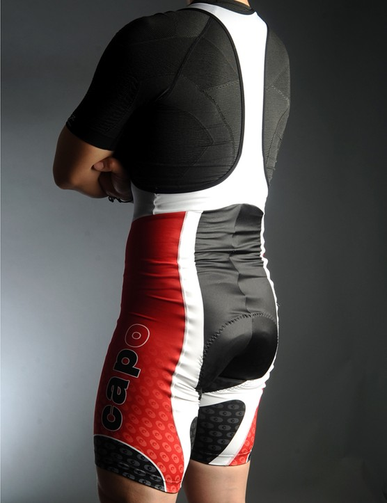 The wrinkles at the lower back disappear when you're on the bike - these are meant for riding, not standing.