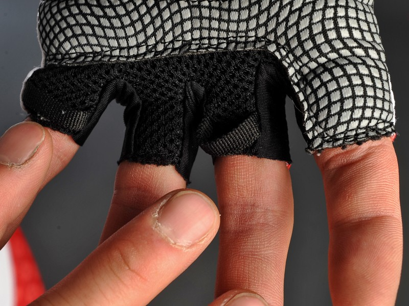 The silicone-enhanced palm offers a firm grip even on untaped carbon bars, mesh panels provide cooling air flow and handy finger loops make it easier to pull the gloves off.