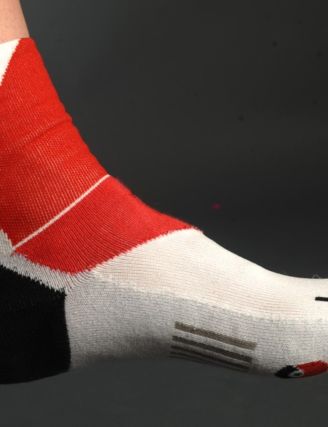 The asymmetrical left- and right-specific socks fit perfectly on your similarly asymmetrical feet - and, of course, ensure the logos are in the right place.