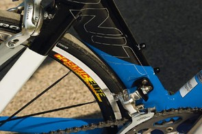 The seat tube, aluminium at the bottom and carbon on top, fits close around the rear wheel to lessen drag