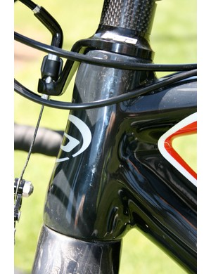 The oversized and tapered head tube stiffens up the front