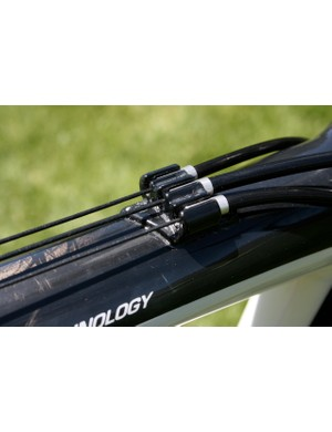 Triple top tube cable stops keep mud out of the shifting equation