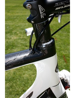 This is becoming a familiar sight with aero road bikes: time trial-like cable routing through the top tube