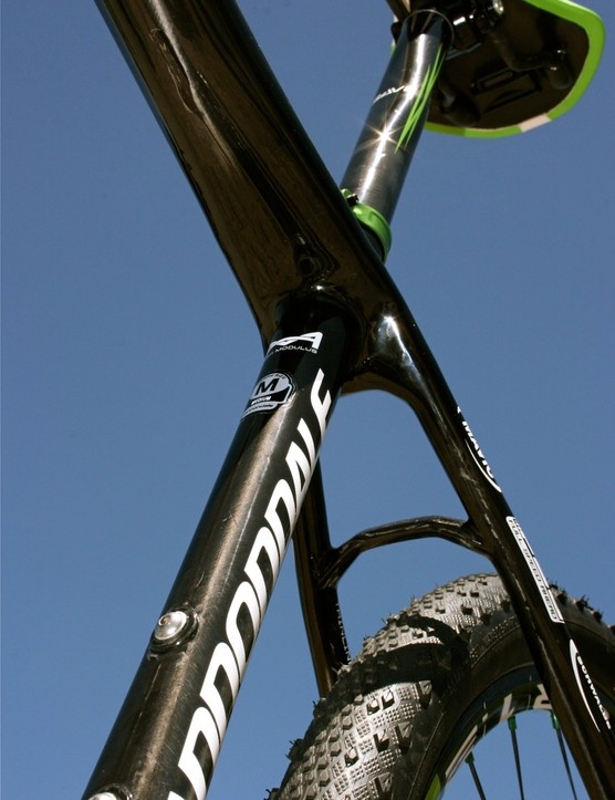 The top tube tapers flat at the seat tube.