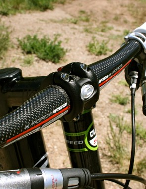 FSA carbon bars and Cannondale's proprietary one-piece forged stem.