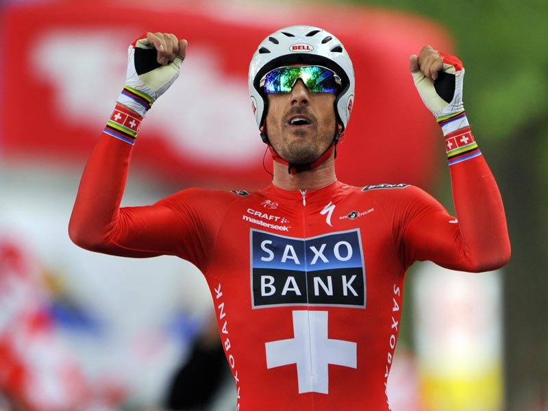 Winner of the Tour de Suisse (Tour of Switzerland) cycling race 2009, Switzerland's Fabian Cancellara celebrates after the final stage, a 38.5 km time-trial, of the 73rd Tour de Suisse on June 21, 2009
