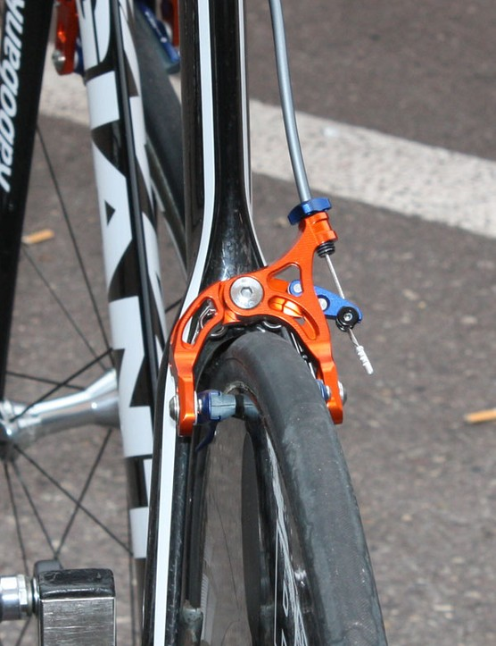 Many team bikes have their rear brakes conventionally mounted on the back of the  seat stays but production bikes will see them moved to below and behind the bottom bracket.