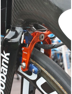 Unless something has changed with the bike's overall configuration and cable routing, the unique scissor-type front brake is likely to be included in the package as virtually nothing else on the market will work.  Don't count on the trick orange and blue anodising, though.