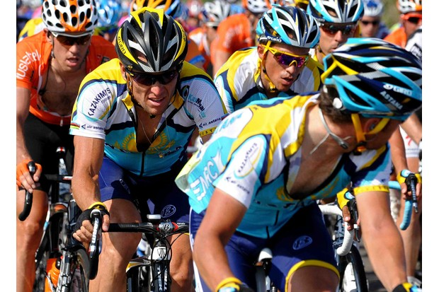 Astana teammates Lance Armstrong (L) and beleagured Spaniard Alberto Contador (C) during Stage 3 of the 2009 Tour.