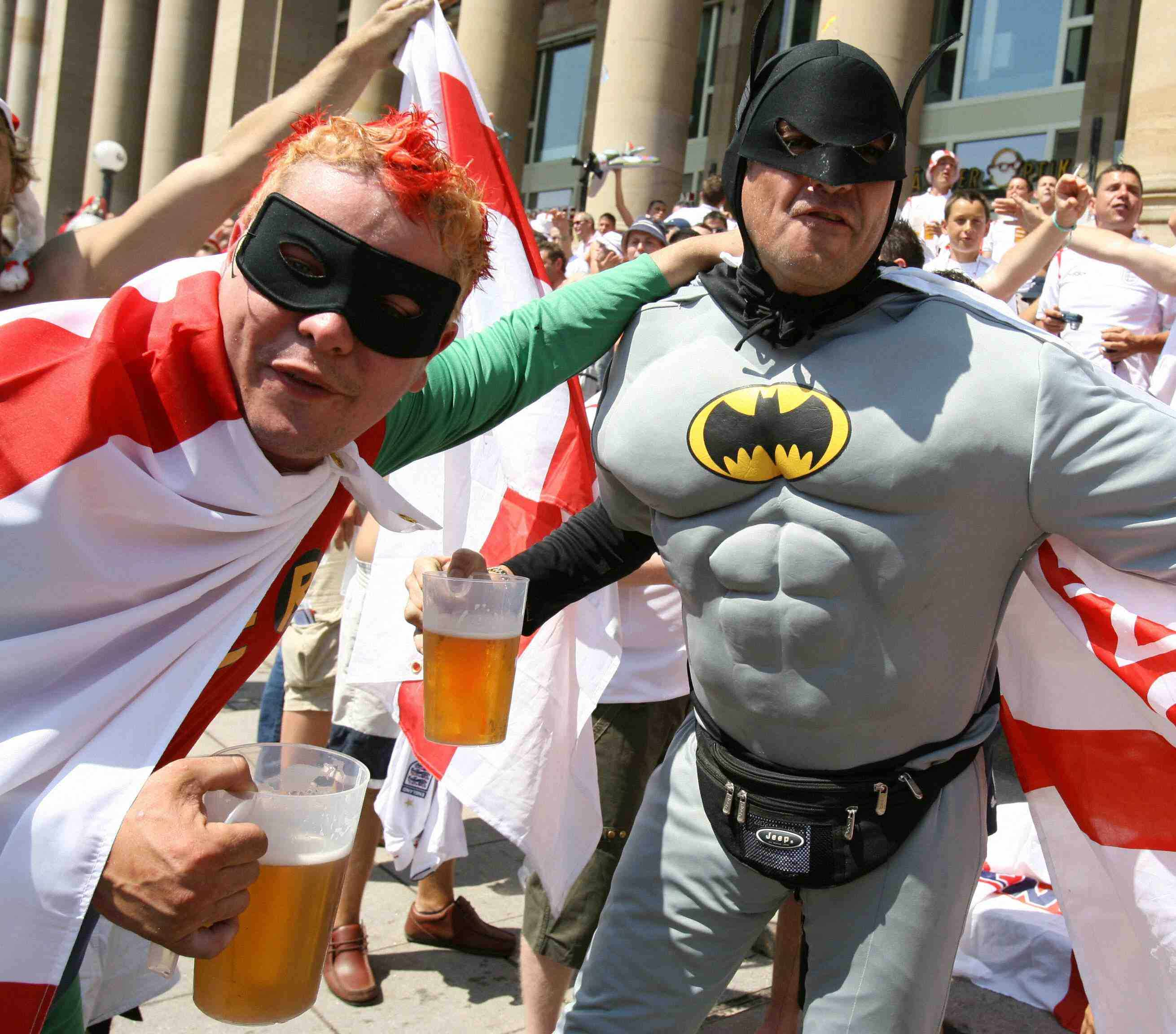 English football supporters dressed as comic heroes 'Batman and Robin' pose in the city centre of Stuttgart, 25 June 2006, prior to the England vs Ecuador match in the 'round of sixteen' FIFA World Cup.
