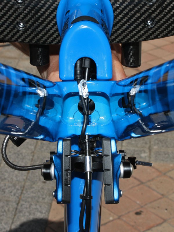 The internally routed cables come down through the lower stem and then jump over into the bottom of the down tube