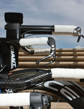 Team bikes typically use straight extensions but most consumers can't maintain that hand position so Giant will likely include the S-bend extensions as stock equipment instead